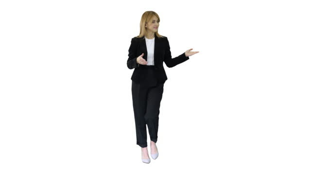 Female presenter blond woman walking and pointing to the sides on white background
