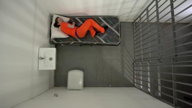 4K AERIAL: Female Prisoner in Jail unable to sleep video