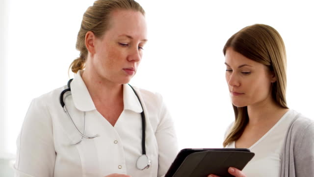 Female professional doctor at work. Woman physician with stethoscope consulting patient in clinic video