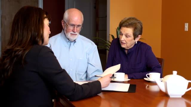 Female Professional Talks with Senior Couple video