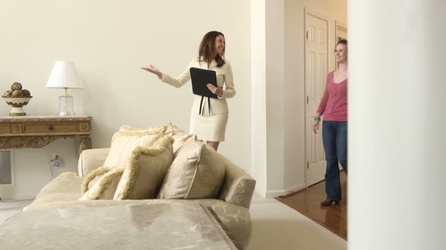 Female Real Estate Agent Showing Home video