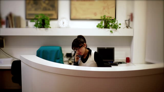 Female receptionist attends the businessman video