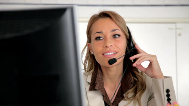Female receptionist working on computer video