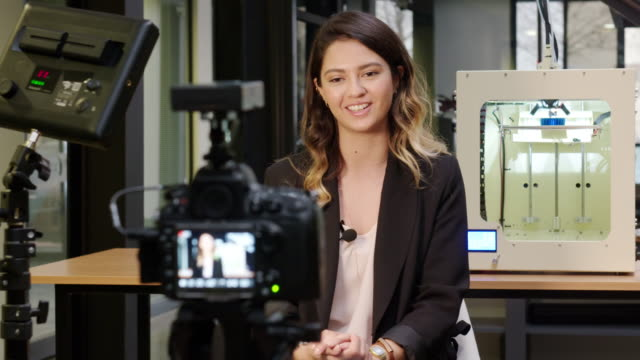 Female reporter in a 3D printing office Female reporter in a 3D printing office. journalist stock videos & royalty-free footage