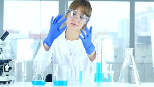 Female Research Scientist Imagining New idea in Laboratory, Creative video