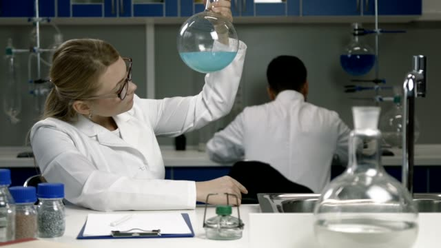 Female researcher working in chemistry lab video