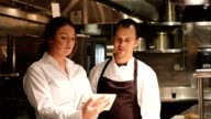 istock Female restaurant manager discussed menu with chef 1189544344
