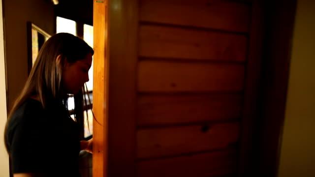 female retrieving clothes from her wardrobe - поститься стоковые видео и кадры b-roll