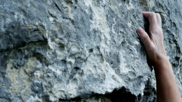 Female Rock Climber Close-up (4K/UHD to HD) video