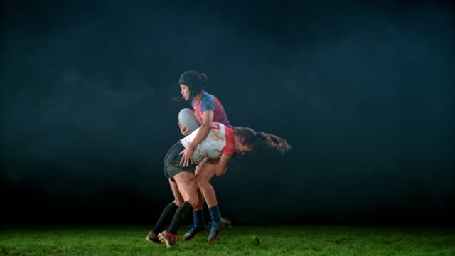 SLO MO LD SPEED RAMP Female rugby player tackling her opponent to the ground Slow motion wide locked down speed ramp shot of a female rugby player running towards her opponent and tackling her to the ground. Shot in Slovenia. rugby stock videos & royalty-free footage