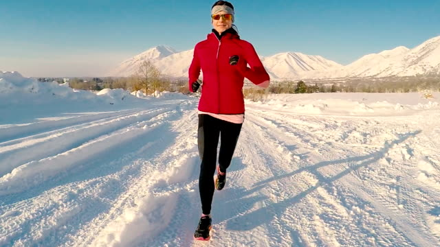 Female Running on Cold Snowy Winter Utah Day video