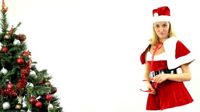 Female Santa smiles and winks video