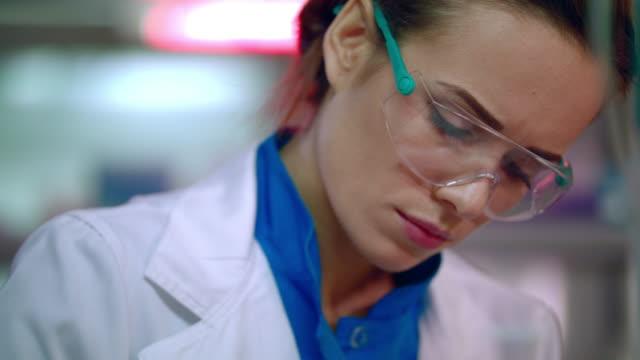 Female scientist face close up. Woman scientist portrait. Medical scientist video