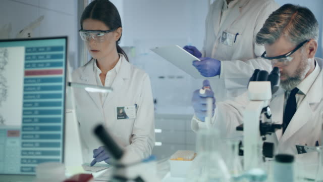 female scientist studying dna mutations. research partner in background - eastern european descent stock videos & royalty-free footage
