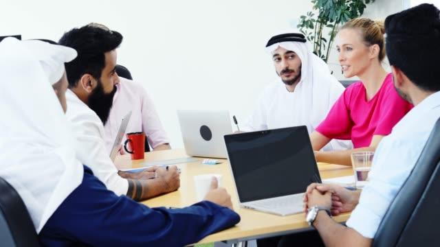 female senior business executive chairing a strategy meeting - arab стоковые видео и кадры b-roll