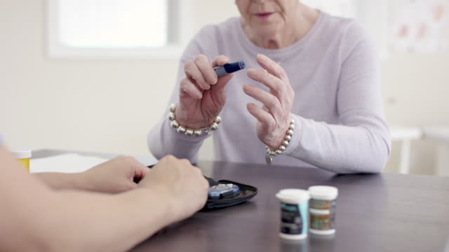 Video Female Senior Patient With Ethnic Nurse In Appointment Learning About Diabetes