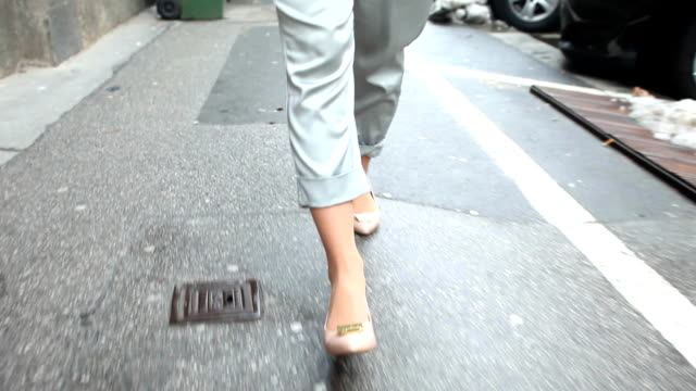 Female shoes walking down the street video