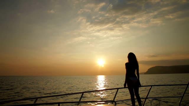 Female Silhouette on Yacht at Sunset video
