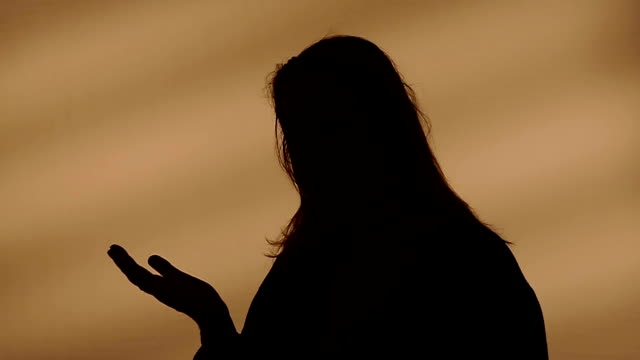 Female silhouette talking with hands video