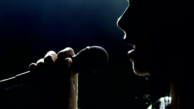 female singer on the stage holding a microphone. - musician stock videos and b-roll footage