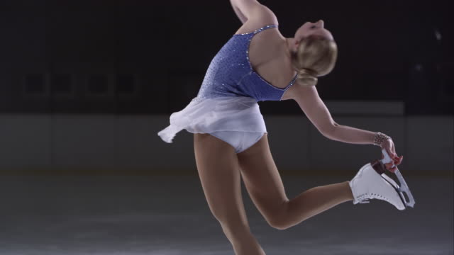 SLO MO TU Female skater moving into catchfoot layback spin video