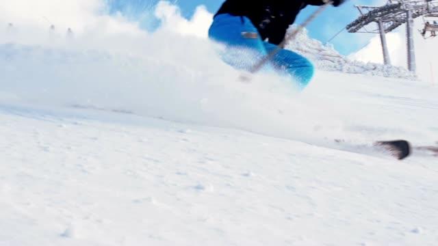 SLO MO Female skier spraying snow at camera video