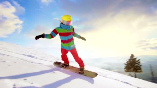 SLO MO Female snowboarder carving on ski slope video