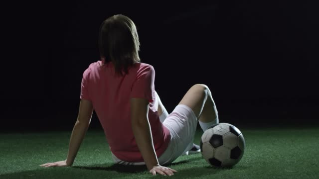 Female Soccer Athlete Resting on Field video