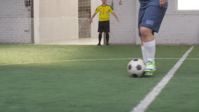 Female Soccer Player Preparing to Shoot Penalty Kick