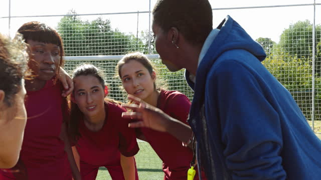 Female soccer players listening to their coach before game Group of female soccer players listening to their african-american female coach before game coach stock videos & royalty-free footage