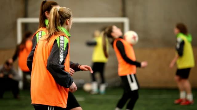 female soccer players passing the ball - kobiecość filmów i materiałów b-roll