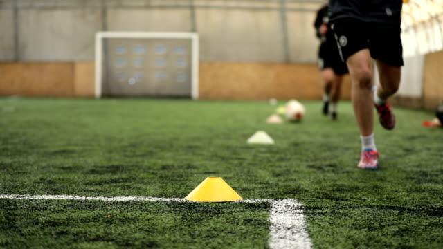 female soccer players running on a soccer field - rozgrzewka filmów i materiałów b-roll