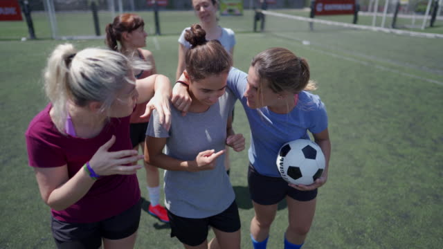 Female soccer players supporting each other before the game starts Female friends walking down soccer field, embracing and supporting each other before the game starts pre game stock videos & royalty-free footage
