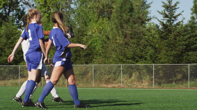Female soccer players warm up before a game video