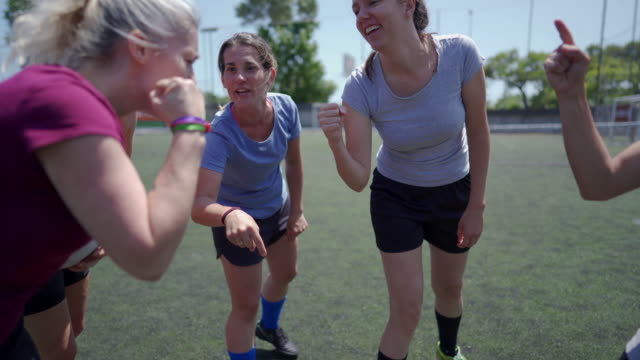 Female soccer team huddling and shouting Female soccer team huddling and shouting before the game starts pre game stock videos & royalty-free footage