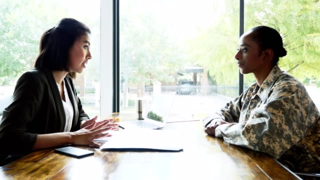 Female soldier meets with bank loan officer