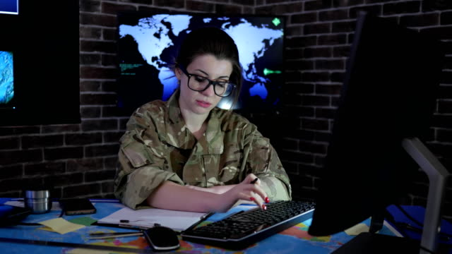 female soldier portrait with computer, IT war, cyber safety video