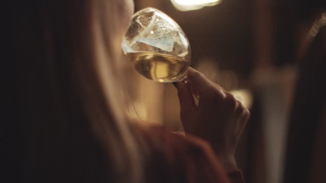Female sommelier tasting wine