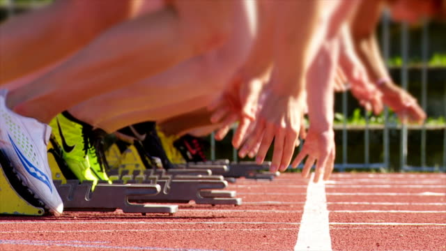 SLO MO Female Sprinters Pushing Off Of The Starting Block