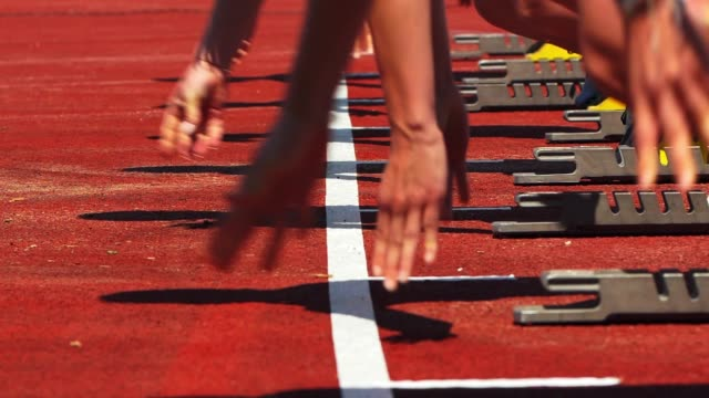 female sprinters starting from the starting block - track and field stock videos and b-roll footage