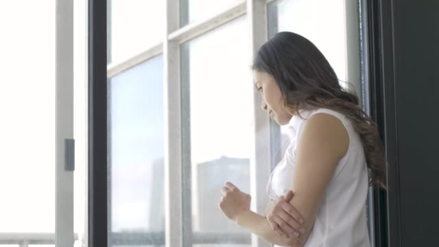 Female Staring Out Window Looking Depressed video