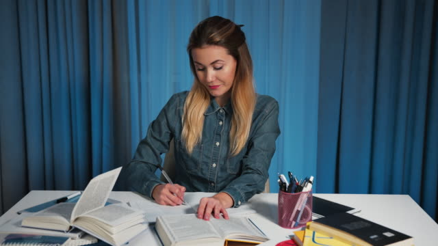 A female student in a denim shirt, yawns from fatigue. A boring homework video