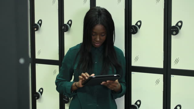 Female student in university with digital tablet video