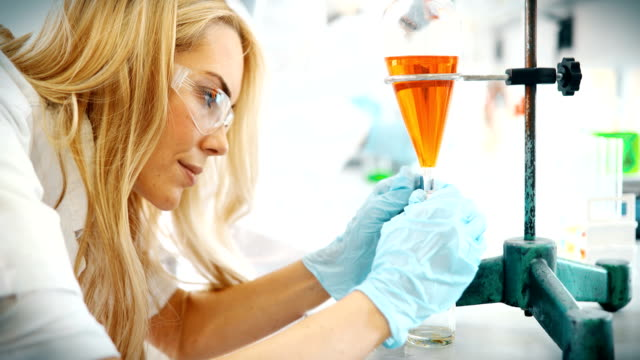 Female student of chemistry working in laboratory video