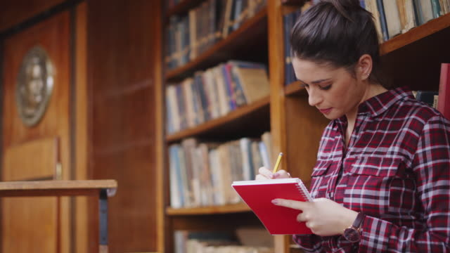 Female student studying at library