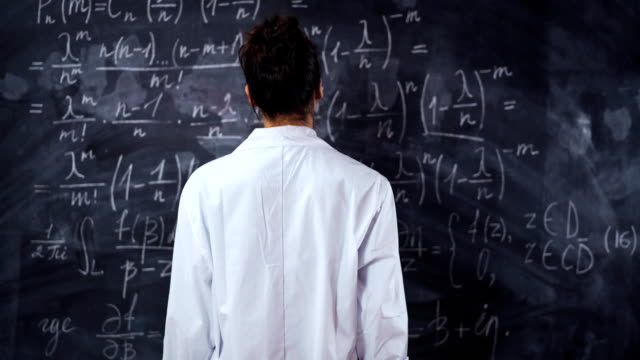 Female student think about equation on board. Solve and prove the theorem video