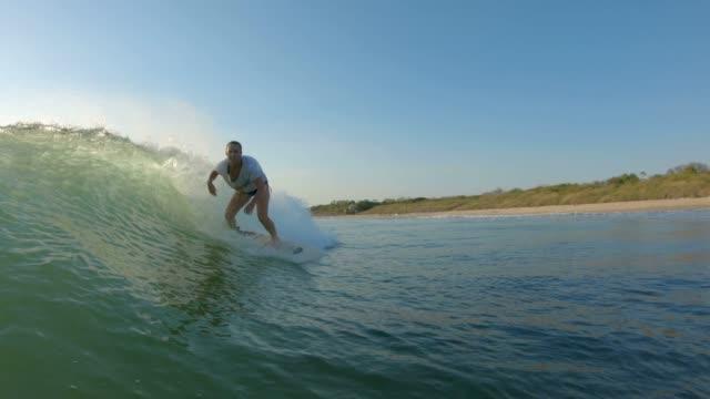 Female Surfer Woman surfing skillfully in Playa Grande, Costa Rica surf stock videos & royalty-free footage