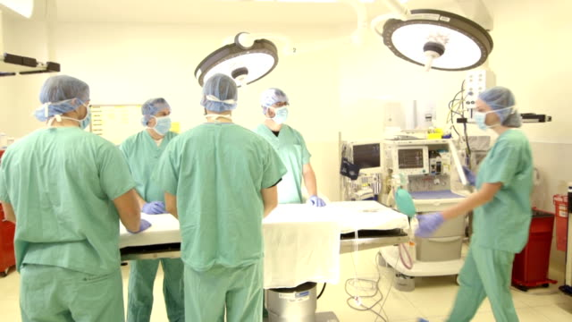 Female Surgeon Briefs Surgical Team in OR video