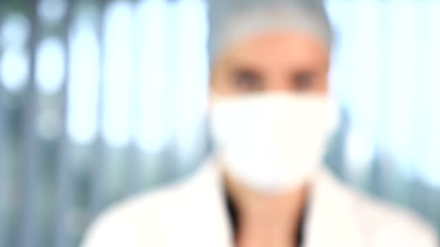 Female surgeon face - zoom in video
