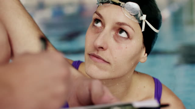 Female swimmer and her coach video